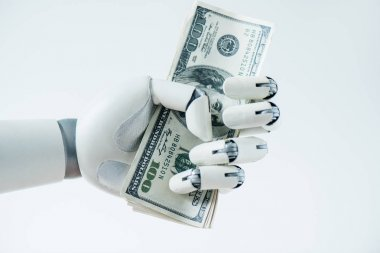 close-up view of robot holding dollar banknotes isolated on white