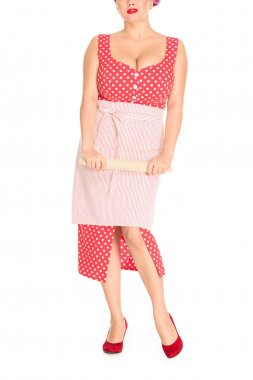 Cropped shot of plus size woman in red dress with apron holding wooden rolling pin isolated on white stock vector