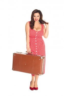 attractive plus size woman holding vintage suitcase isolated on white