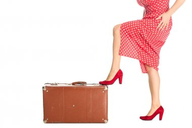 cropped shot of woman with vintage suitcase isolated on white