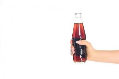 cropped shot of woman holding bottle of soda isolated on white