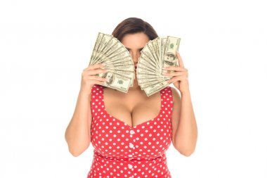 beautiful plus size woman covering face with lot of cash isolated on white