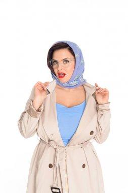 close-up portrait of stylish plus size woman in kerchief and stylish eyeglasses isolated on white