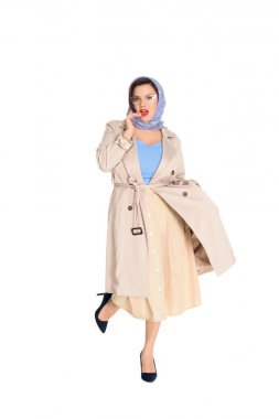 beautiful plus size woman in stylish trench coat and kerchief isolated on white