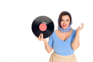 beautiful stylish pin up girl holding vinyl record and smiling at camera isolated on white