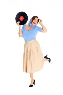 beautiful happy pin up woman holding vinyl record isolated on white