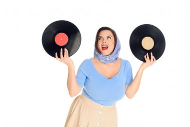 happy stylish pin up woman holding vinyl records isolated on white