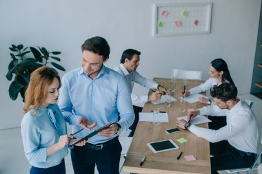 selective focus of business coworkers having discussion during business training in office