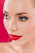 close up view of beautiful woman with red lips isolated on red