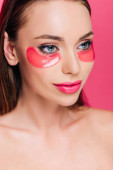 naked beautiful woman with eye patch on face isolated on pink