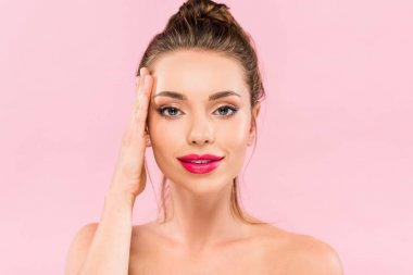 Naked beautiful woman with pink lips posing with hand on face isolated on pink stock vector