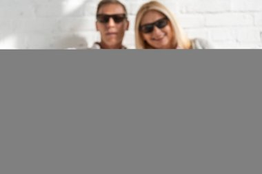Selective focus on couple in 3d glasses with popcorn on bed