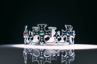 Antique silver crown with gemstones on black stock vector