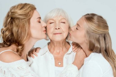 Granddaughter and mother kissing grandmother with closed eyes isolated on grey stock vector
