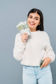 smiling pretty girl in white sweater holding euro banknotes isolated on grey