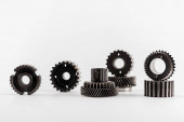 metal round gears on white background with copy space
