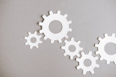 Photo top view of white gears on grey background