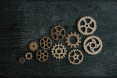 top view of retro metal gears on dark wooden background