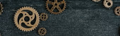 Photo top view of vintage metal gears on dark wooden background with copy space, panoramic shot