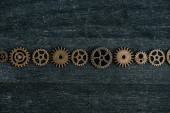 flat lay with vintage metal gears on dark wooden background