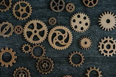 Top view of vintage metal gears on dark wooden background stock vector