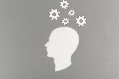 Top view of cut out white human head with gears isolated on grey stock vector