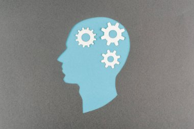 Top view of cut out blue human head with white gears isolated on grey stock vector