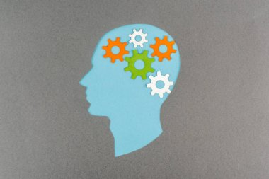 Top view of cut out blue human head with colorful gears isolated on grey stock vector