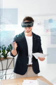 smiling businessman in shirt with virtual reality headset holding pen and papers near startup illustration