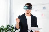 Fotografie businessman in shirt with virtual reality headset with cyber security illustration holding pen and papers