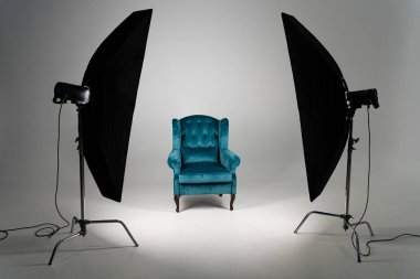 Blue armchair with studio light on grey background stock vector