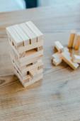 KYIV, UKRAINE - NOVEMBER 22, 2019: selective focus of wooden blocks stack game on table