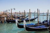 VENICE, ITALY - SEPTEMBER 24, 2019: canal with blue gondolas in Venice, Italy