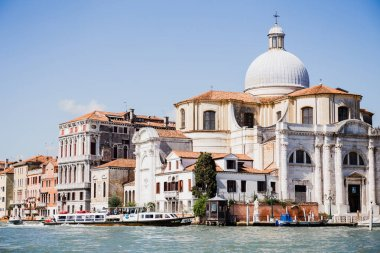 VENICE, ITALY - SEPTEMBER 24, 2019: canal with vaporettos near Santa Maria della Salute in Venice, Italy stock vector