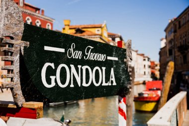 VENICE, ITALY - SEPTEMBER 24, 2019: selective focus of signboard with san trovaso gondola lettering and ancient buildings on background in Venice, Italy stock vector