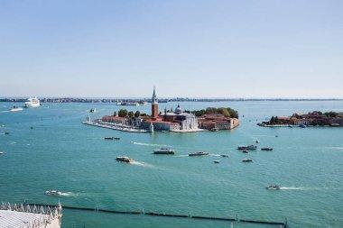 San Giorgio Maggiore island and motor boats floating on river in Venice, Italy stock vector