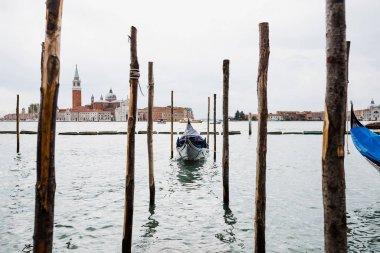 Gondola floating on river and San Giorgio Maggiore island in Venice, Italy stock vector