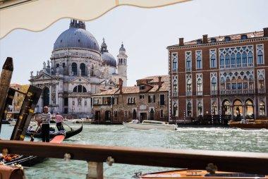 VENICE, ITALY - SEPTEMBER 24, 2019: motor boats and gondolas floating on canal near Santa Maria della Salute church stock vector