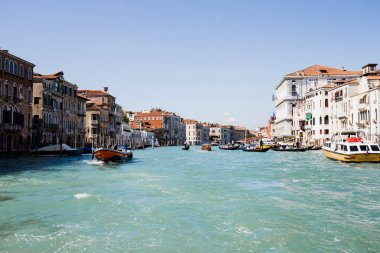 VENICE, ITALY - SEPTEMBER 24, 2019: vaporetto and motor boat floating on canal in Venice, Italy stock vector