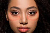 beautiful african american girl with hydrogel eye patches