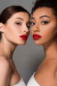 beautiful nude multiracial girls with red lips, isolated on grey