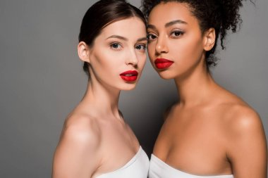 attractive multicultural women with red lips, on grey
