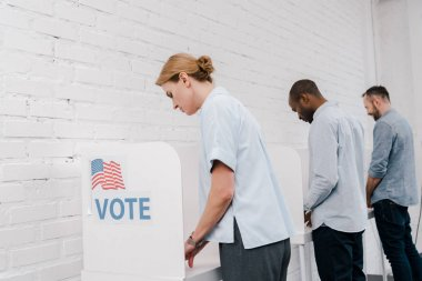 selective focus of multicultural citizens voting near brick wall