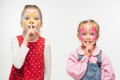 adorable friends with cat muzzle and butterfly paintings on faces showing hush sign isolated on white