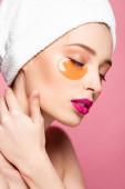 pretty girl with eye patches and closed eyes isolated on pink