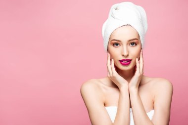 Beautiful young woman in white towel touching face isolated on pink stock vector