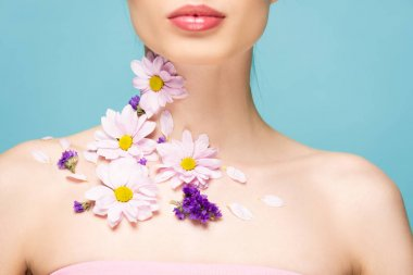 Cropped view of woman with flowers on neck isolated on blue stock vector