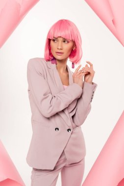 Fashionable girl in suit and pink wig posing in torn paper, isolated on white stock vector