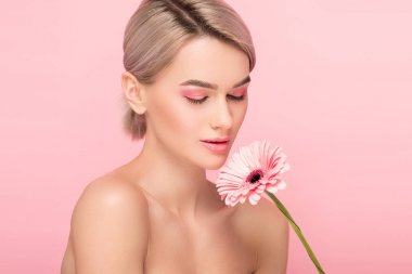 Nude girl with closed eyes holding gerbera flower, isolated on pink stock vector