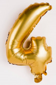 Photo Decorative balloon in shape of four number on grey background